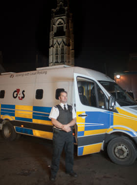 G4S Police Support Services staff member Marcus Bloomfield posing for a portrait outside the street to suite van in Boston, Lincolnshire UK on Oct 31 2013