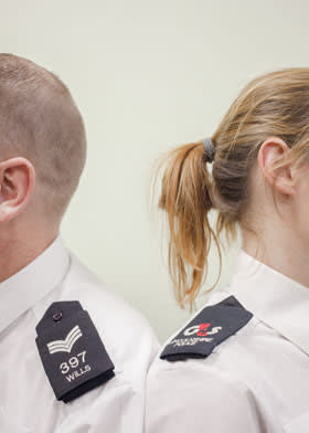 A branded epaulette is the only obvious difference between G4S support services employee Laura Greenley (right) and Sergeant Wills at Boston Police Station