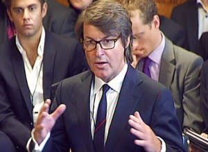 Buckles apologising to MPs for the 2012 Olympics 'shambles' when the company failed to supply enough security staff