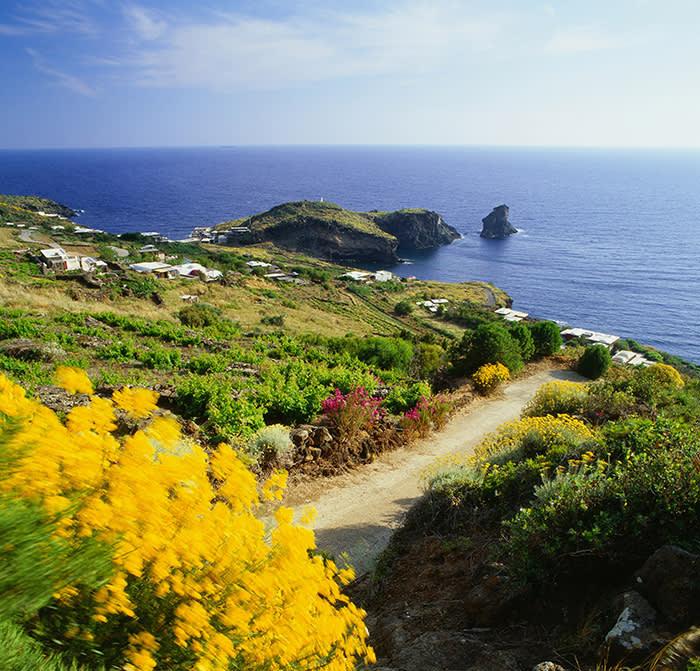 Italy, Sicily, Trapani district, Pantelleria, Cala Levante, Mediterranean sea, View towards the inlet and the Faraglione