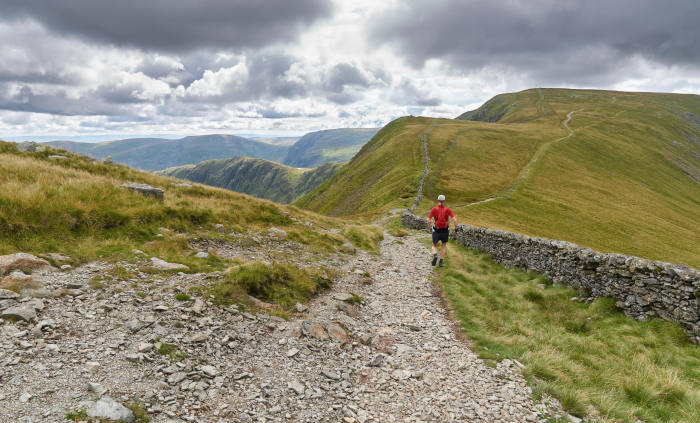 F72Y96 A man fell running down from The Knott and on towards the summit of High Street in the English Lake District, UK.