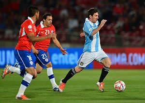 Messi (right) in a World Cup qualifier match against Chile