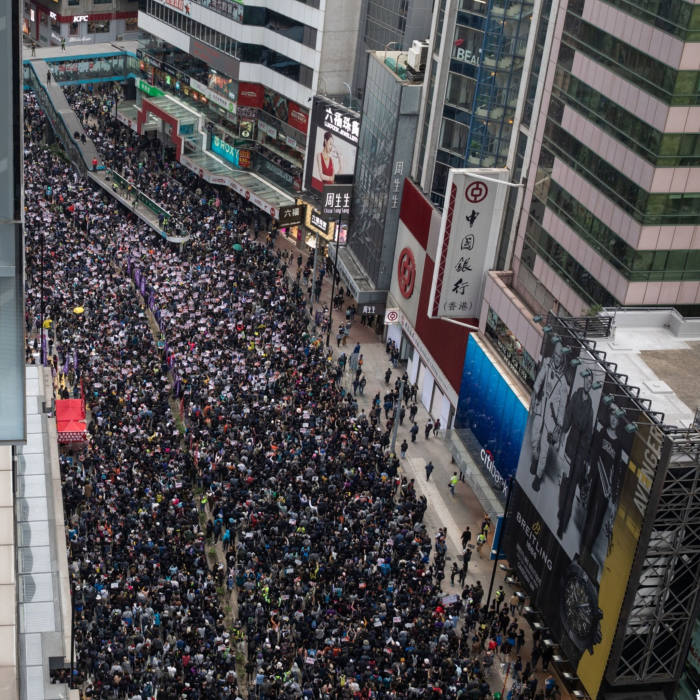Demonstrators march toward central during a protest in the Causeway Bay district of Hong Kong, China, on Wednesday, Jan. 1, 2020. Hong Kong's turbulence shows no sign of abating in 2020, with the new year marked by rallies showing continued resistance against Beijing's tightening grip over the financial hub. Photographer: Kyle Lam/Bloomberg
