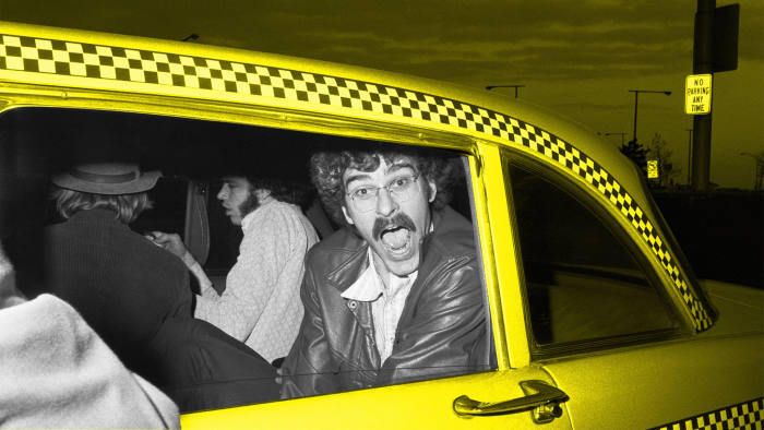 (Original Caption) 4/29/1973-New York, NY- Knick's Phil Jackson prepares to enter a cab at LaGuardia Airport, after the team's return from Boston and a 94-78 win over the Celtics. The Knicks will meet the Los Angeles Lakers in the NBA championship series.