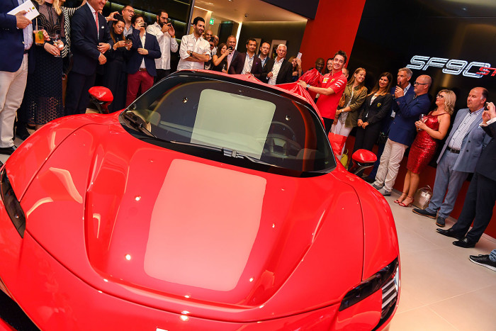 LONDON, ENGLAND - JULY 11: Charles Leclerc unveils the SF90 Stradale at the opening of H.R. Owen's new Ferrari showroom on Berkeley Square on July 11, 2019 in London, England. (Photo by Mike Marsland/Getty Images for Ferrari North Europe)