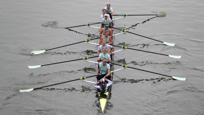 The Cambridge boat, crewed by (bottom to top) cox Sophie Shapter, Olivia Coffey, Myriam Goudet-Boukhatmi, Alice White, Kelsey Barolak, Thea Zabell, Paula Wesselmann, Imogen Grant, and Tricia Smith react after finishing ahead of the Oxford boat to win the annual women's boat race between Oxford University and Cambridge University on the River Thames in London on March 24, 2018. / AFP PHOTO / Daniel LEAL-OLIVAS (Photo credit should read DANIEL LEAL-OLIVAS/AFP via Getty Images)