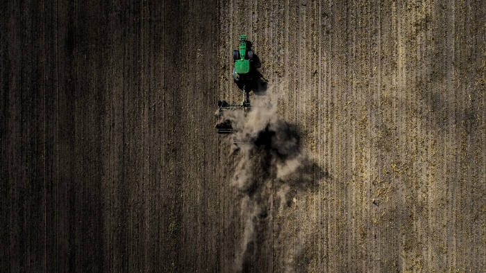 NEUHARDENBERG, GERMANY - SEPTEMBER 06: Aerial view to a tractor during its work on a dry field on September 06, 2018 in Neuhardenberg, Germany. (Photo by Florian Gaertner/Photothek via Getty Images)