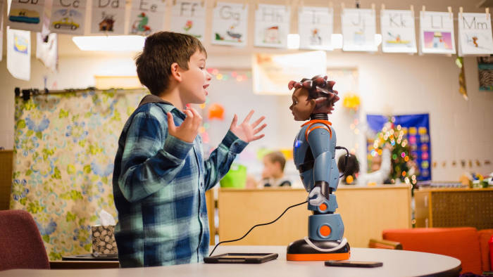 "Devin Chaplin, 7, plays a game of ""Red Light, Green Light"" with Milo, the robot, during some exercises in Julie Jeffcoat's classroom at Kingsbury Elementary."