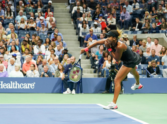 Osaka serving against Serena Williams during the final of the US Open, which she won in straight sets. Asked how it felt playing in the biggest match of her career, she says: 'I [didn't] really notice the crowd. It [was] kind of dialled down. When I watch the match back, I hear it more than I did when I was playing.'