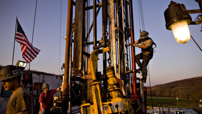 Shale Gas Costing 2/3 Less Than OPEC Oil Converges With U.S....Nomac Drilling Corp. derrick man Justin Spruell, right, climbs down from an overhead platform after connecting a section of drill pipe on a Chesapeake Energy Corp. natural gas drill site in Bradford County, Pennsylvania, U.S., on Tuesday, April 6, 2010. Companies are spending billions to dislodge natural gas from a band of shale-sedimentary rock called the Marcellus shale that underlies Pennsylvania, West Virginia and New York. The band of rock, so designated because it pokes through near a city of that name in northern New York, may contain 262 trillion cubic feet of recoverable gas, the U.S. Department of Energy estimates. Photographer: Daniel Acker/Bloomberg