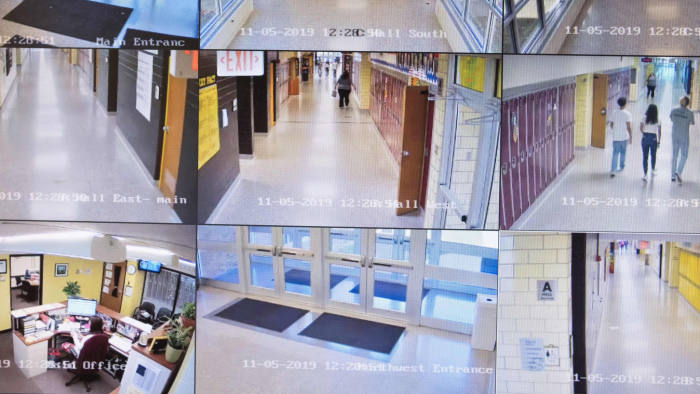 "Video cameras monitor the halls of Sidney High School in the attendance office of the school in Sidney, Ohio, October 31, 2019. - At the entrance to Sidney High School in small-town Ohio, there is a poster which reads: ""Inside this building, our children are protected by an armed and trained response team."" In rural Shelby County, law enforcement has trained teachers to fight back, should an attacker threaten students. They are among the first in the United States to embrace the controversial strategy. (Photo by Megan JELINGER / AFP) (Photo by MEGAN JELINGER/AFP via Getty Images)"