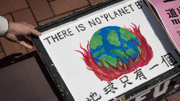 HONG KONG, CHINA - SEPTEMBER 20: A protesters takes a sign during the Hong Kong Climate Strike rally on September 20, 2019 in Hong Kong, China. People attended rallies all across the world as part of a global Climate Strike day, demanding action on climate change. (Photo by Chris McGrath/Getty Images)