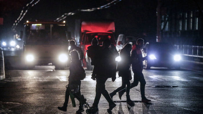 People cross a road during a power outage in the Crimean city of Simferopol on November 24, 2015. Power cuts in Crimea affected nearly 940,000 people on November 24 as tensions raged between Kiev and Moscow over the annexed peninsula and Russia threatened to cut off gas supplies to Ukraine. AFP PHOTO / MAX VETROV / AFP / MAX VETROV (Photo credit should read MAX VETROV/AFP/Getty Images)