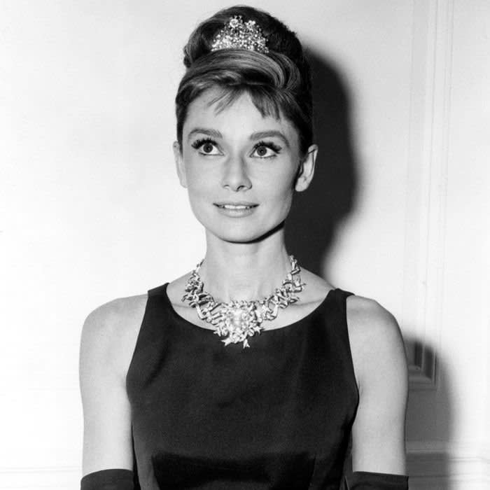 Editorial use only. No book cover usage. Mandatory Credit: Photo by Paramount/Kobal/REX/Shutterstock (5886249t) Audrey Hepburn Breakfast At Tiffany's - 1961 Director: Blake Edwards Paramount USA On/Off Set Comedy Breakfast At Tiffanys Diamants sur canapé