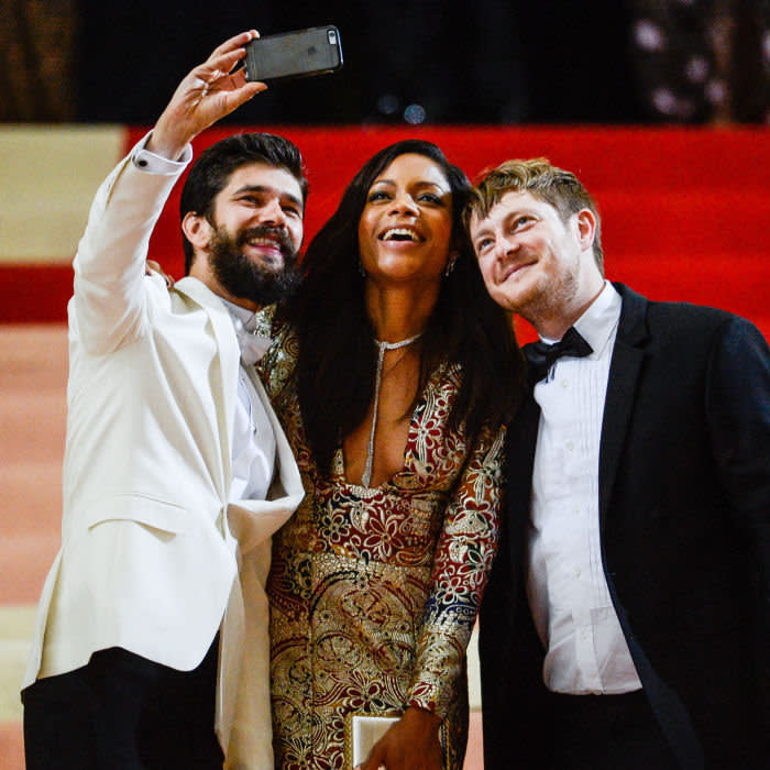 """NEW YORK, NY - MAY 02: (L to R) Actors Ben Whishaw, Naomie Harris, and musician Mark Bradshaw leave the """"Manus x Machina: Fashion In An Age Of Technology"""" Costume Institute Gala at the Metropolitan Museum Of Art on May 2, 2016 in New York City. (Photo by Ray Tamarra/GC Images)"""