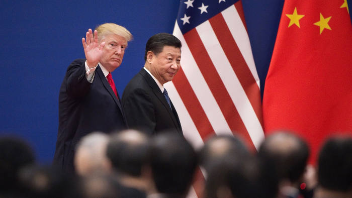 "TOPSHOT - US President Donald Trump (L) and China's President Xi Jinping leave a business leaders event at the Great Hall of the People in Beijing on November 9, 2017. Donald Trump urged Chinese leader Xi Jinping to work ""hard"" and act fast to help resolve the North Korean nuclear crisis, during their meeting in Beijing on November 9, warning that ""time is quickly running out"". / AFP PHOTO / Nicolas ASFOURI        (Photo credit should read NICOLAS ASFOURI/AFP/Getty Images)"