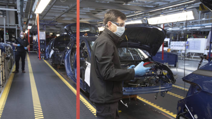 Members of staff working between two-metre wide designated work stations on a car assembly line at the Vauxhall car factory during preparedness tests and redesign ahead of re-opening following the COVID-19 outbreak. Located in Ellesmere Port, Wirral, the factory opened in 1962 and currently employs around 1100 workers. It ceased production on 17 March 2020 and will only resume work upon the advice of the UK Government, which will involve stringent physical distancing measures being in place across the site. (Photo by Colin McPherson/Corbis via Getty Images)