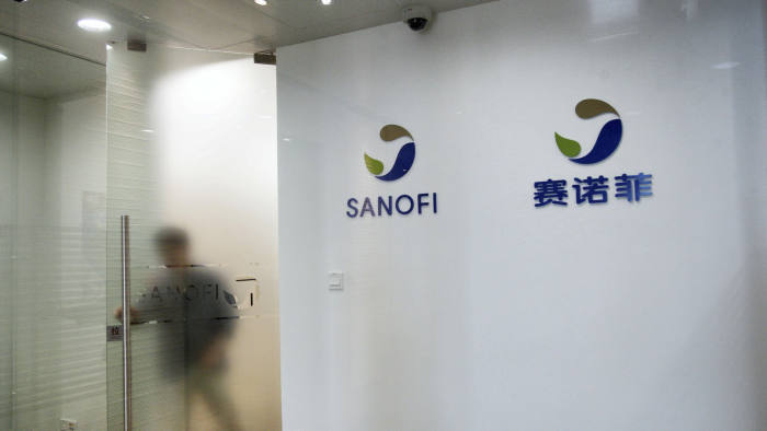 W8ERYW --FILE--A Chinese employee walks out of the office of Sanofi (China) Investment Co., Ltd. in Shanghai, China, 9 August 2013. French pharmaceutical g