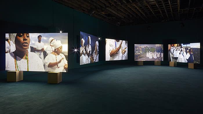 Victoria MiroIsaac Julien, Lina Bo Bardi - A Marvellous Entanglement, 2019, Nine screen installation, Super High Definition (4K), Colour, 9.1 Surround Sound and ash wood plinths Fabrice Gibert