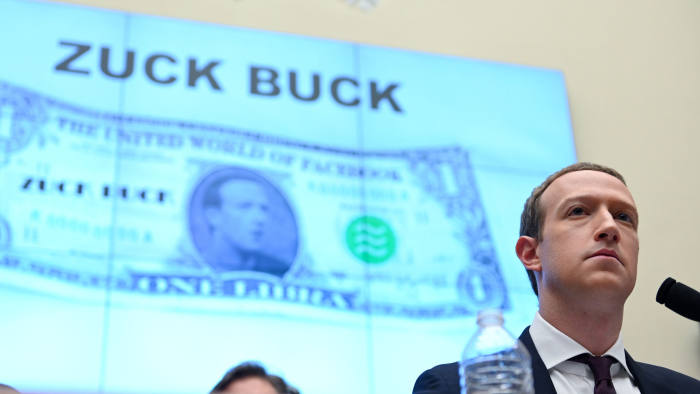 """Facebook Chairman and CEO Mark Zuckerberg testifies in front of a projection of a """"Zuck Buck"""" at a House Financial Services Committee hearing examining the company's plan to launch a digital currency on Capitol Hill in Washington, U.S., October 23, 2019. REUTERS/Erin Scott"""