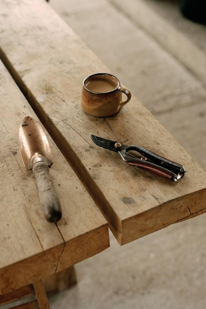 An Implementations trowel, Hidehisa Kurumi secateurs and a Micki Schloessingk cup