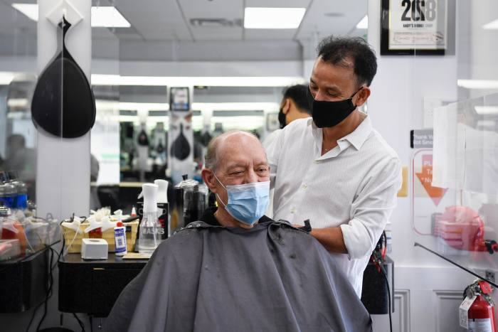 UNITED STATES - SEPTEMBER 3: Owner Andy Ton, right, gives James Henry a haircut at Andys Barber Shop on Thursday, Sept. 3, 2020. (Photo by Caroline Brehman/CQ-Roll Call, Inc via Getty Images)
