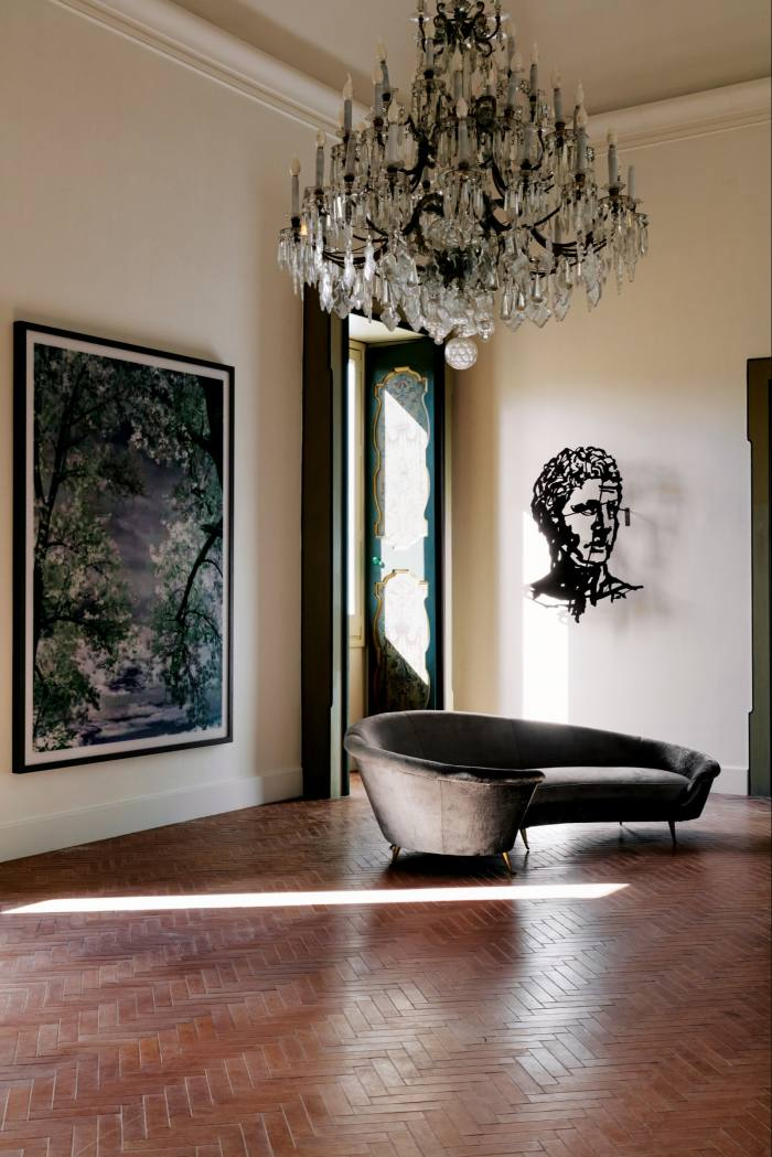 """In the main salon, Thomas Ruff's """"jpeg tj01"""" C-print, 2007, hangs between two windows, with William Kentridge's """"Head (ManLooking Left)"""", 2017,on the right"""