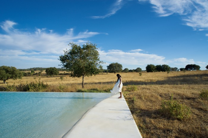 The author at the edge of the pool at Casa no Tempo