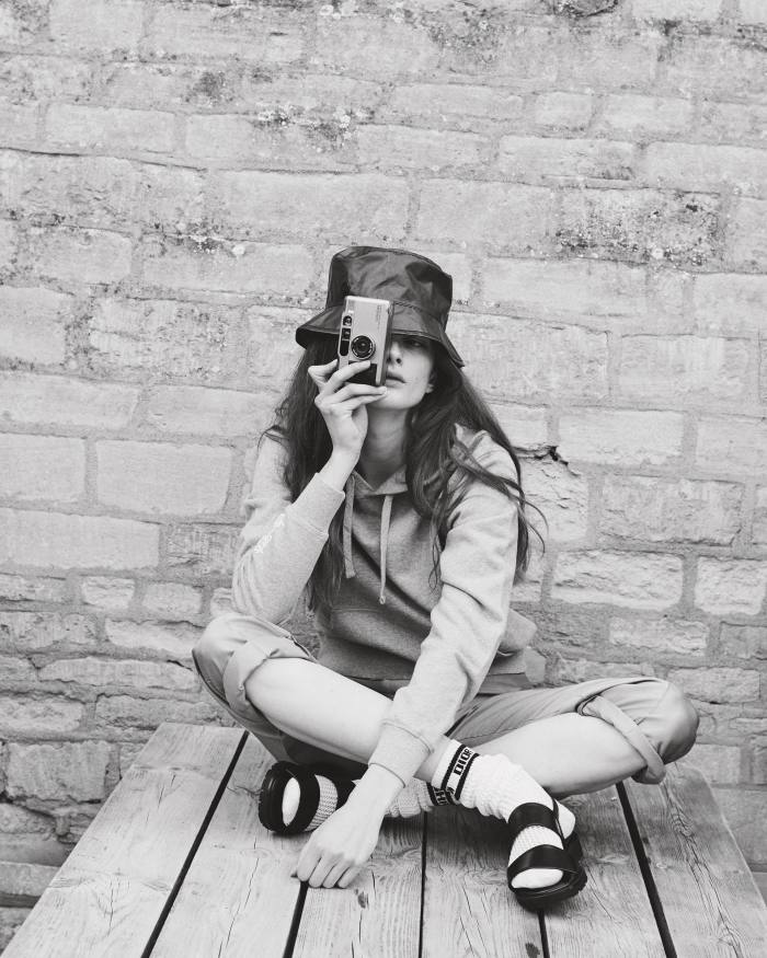 Primrose wears Les Girls Les Boys cotton hoodie, £75.  Giorgio Armani satin trousers, £1,600. Maison Michel PVC Axel hat, £339. Diorcotton socks, £340. Manolo Blahnik leather Bulgobis sandals, £575