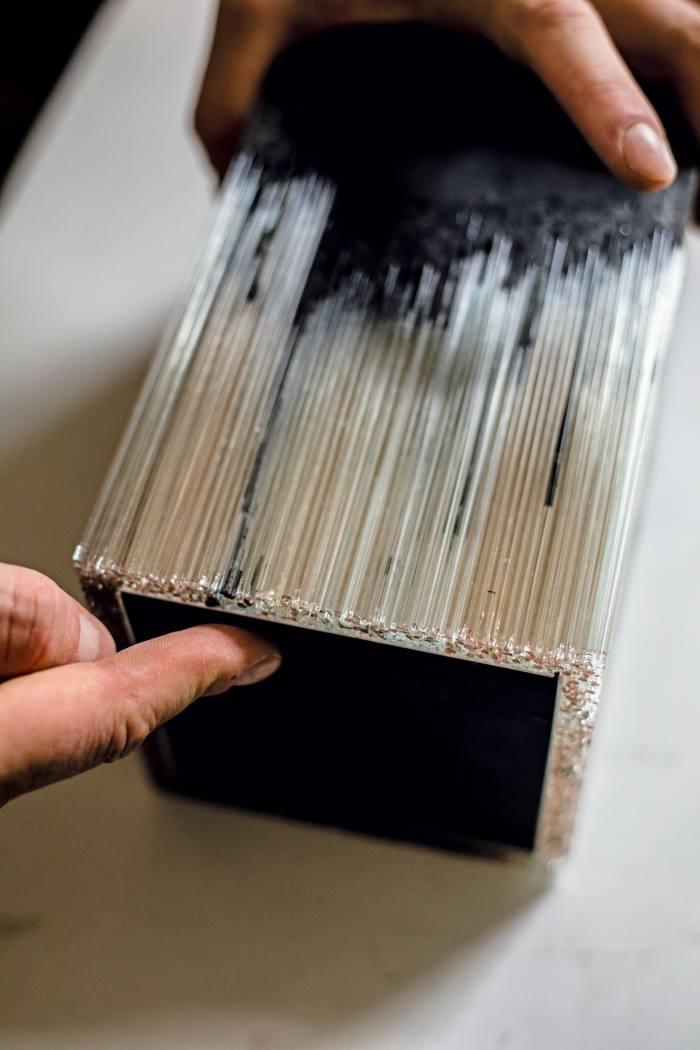 A work in progress illustrating Morgan's glass-pulling method