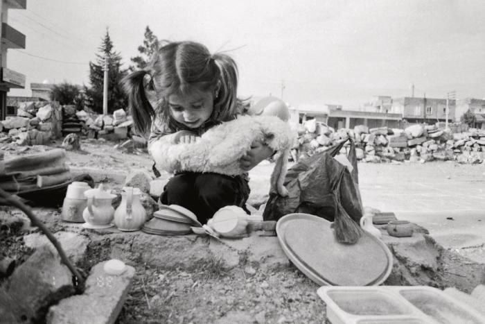 A photograph by Sevin of her sister playing outside