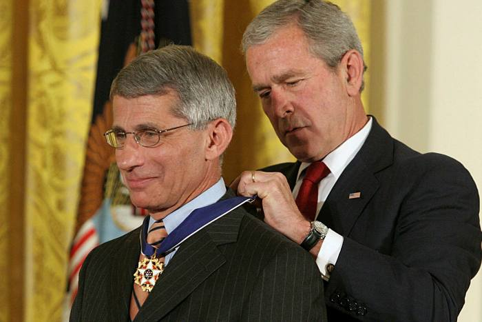 Receiving the Presidential Medal of Freedom from George W Bush in 2008