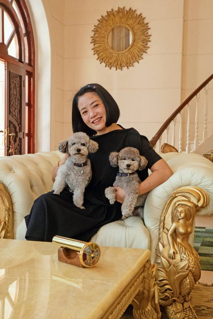 """Fashion designer Guo Pei at home in Beijing with her poodles Nuomi (""""Sticky Rice"""", near right) and Zhuanzhuan"""