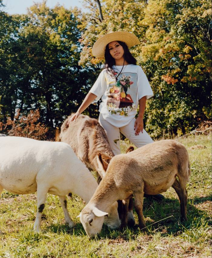 Members of NYC community activist group Playground Youth model the farm'smerchandise