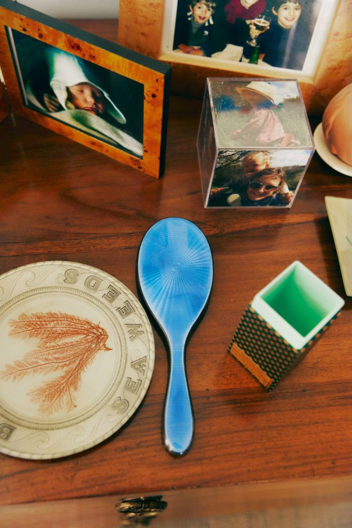 A John Derian plate, antique enamel mirror, and photographs of Konig with Margot