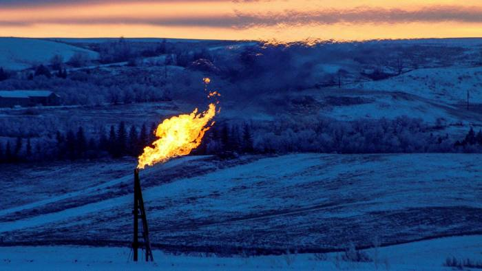 A natural gas flare burns at an oil well in North Dakota