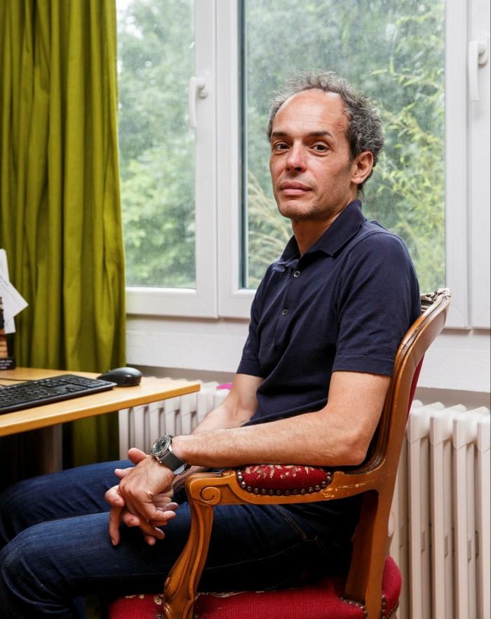 Davide Uglietti poses for a portrait in his home in Brugg, Switzerland.