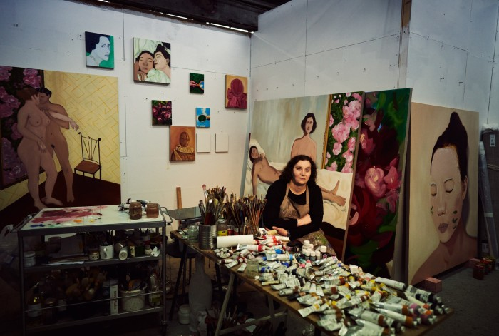 Victoria Cantons in her studio in Brixton. Large artworks, from far left, TheOrder of Love OrWhile The World Burns Outside (2020-21). LeVisage De L'Amour Or The Maze (2021). What Survives of Us (2020). Left:A New Landmark (2020)