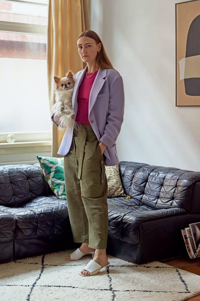 Fashion designer Elza Wandler at home with herchihuahua Billy