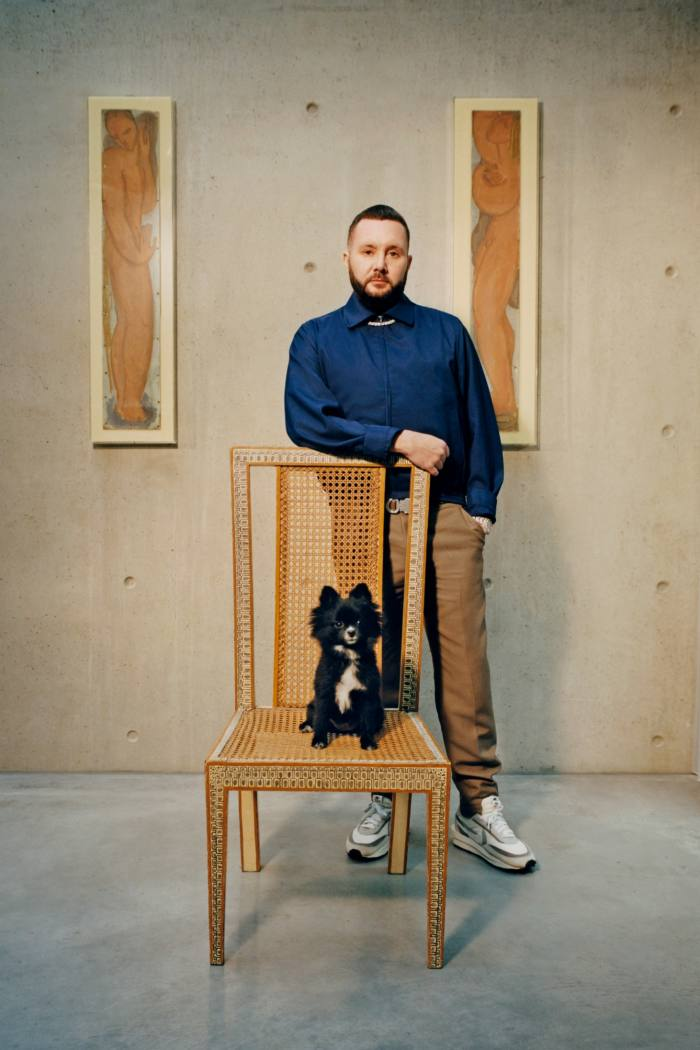 Kim Jones, artistic director of Dior Homme and artistic director of Fendi womenswear and couture, at home in London with his Pomeranian named Cookie, one of his fourdogs
