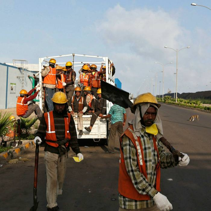 Workers arrive at Mundra Port Coal Terminal in the western Indian state of Gujarat