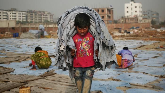 Ten-year old Mustakin working in Dhaka, Bangladesh, for one dollar a day