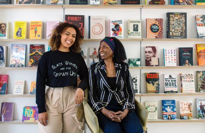 Schomburg Shop associates Malaika Temba (left) and Virginia Mixon at the store