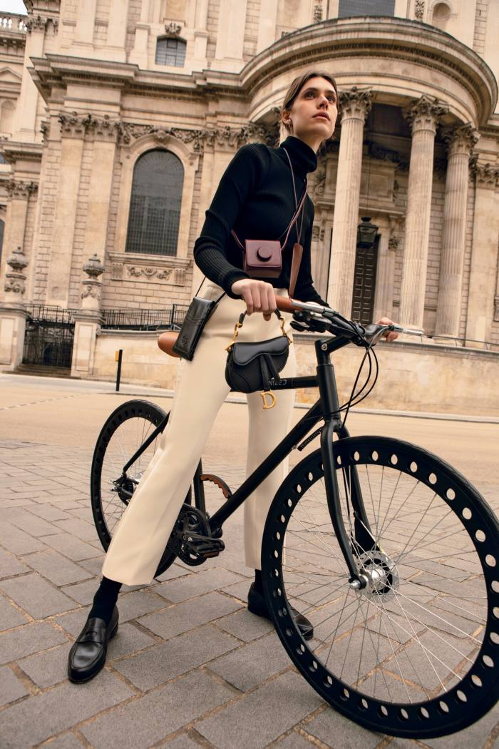 Dior cashmere rollneck, £1,500, wool and silk trousers, £1,100, and leather Saddle micro bag (held in front), £1,800. Succo bamboo socks, €32. John Lobb leather Lopez loafers, £1,015. Accessories, from left: Alexander McQueen leather TheCurve phone holder, £420. Lemaire leather Mini Camera bag, €490. Del'ep leather Smart glasses case, €145
