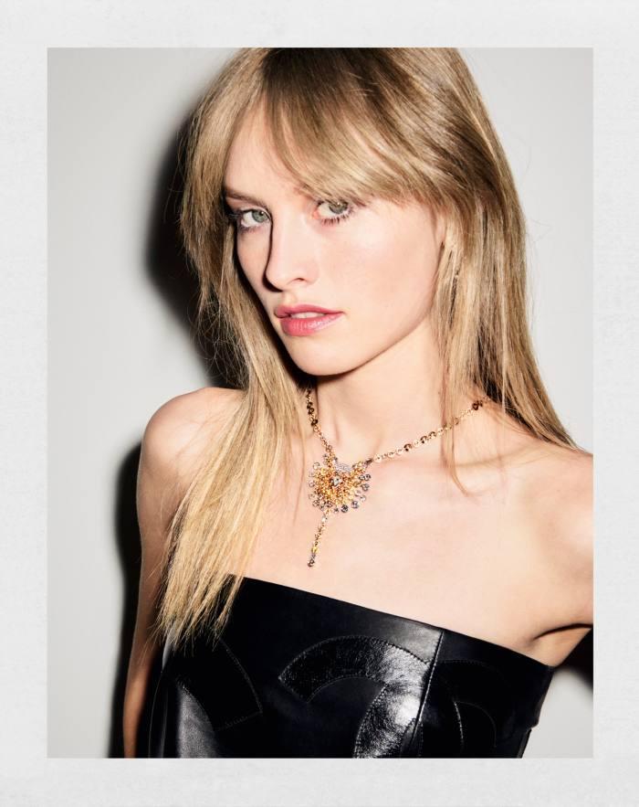 Klara wears Chanel High Jewellery yellow-gold, platinum, diamond,spessartite garnet andyellow sapphire Golden Sillage necklace, POA, part of the No 5 collection. Chanelleather skirt (wornastop), £5,070