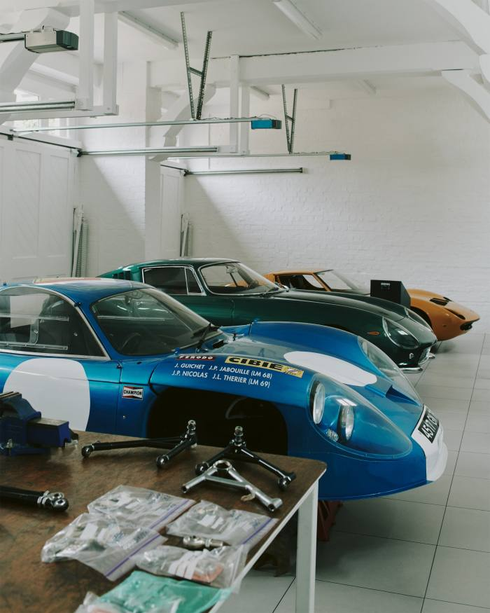 Berryman's garage with some of his collection of 1960s European sports cars