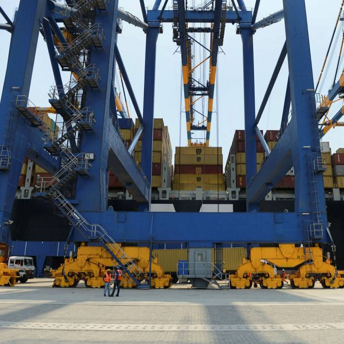 Containers are unloaded at Adani Ports and Special Economic Zone at Mundra, some 400 kms from Ahmedabad