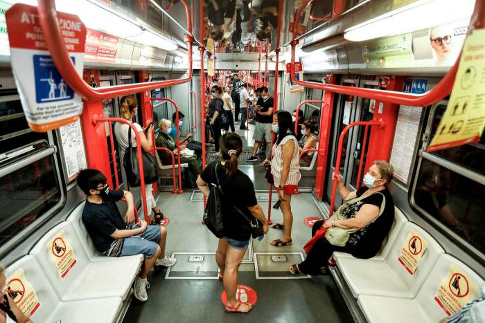 Subway passengers wear face masks in Milan, northern Italy