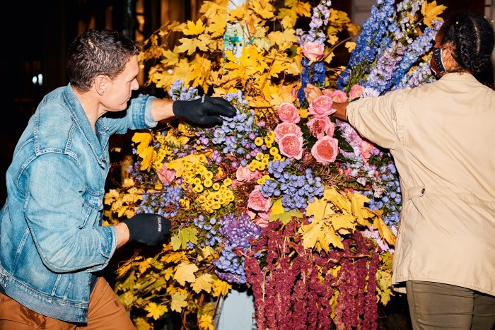 Lewis Miller and his assistant Tawana work on the Flower Flash