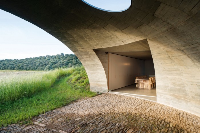 The dining area at Casa na Terra opens on to a stone terrace